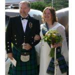 Groom in Gunn Modern Tartan kilt and Bride with new sash - welcome to the clan!