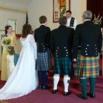 Traditional Scottish Wedding, kilts & sashes in each person's family tartan