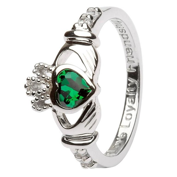 sterling silver claddagh ring with the may birthstone, an emerald colored crystal, and engraved with love loyalty friendship