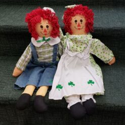 Irish Raggedy Ann and Andy seated on stairs