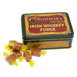 Connemara Kitchen Whisky Fudge with a few laid out in front of a decorative tin