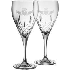 pair of galway crystal red wine glasses with claddaghs etched on them